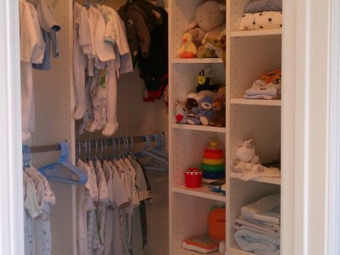 Walk In Kids Closet in White Melamine with Chrome Rods and slab drawer faces