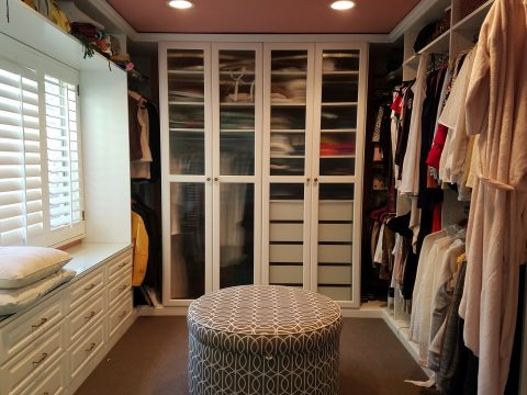 custom closet with cloths and shoes