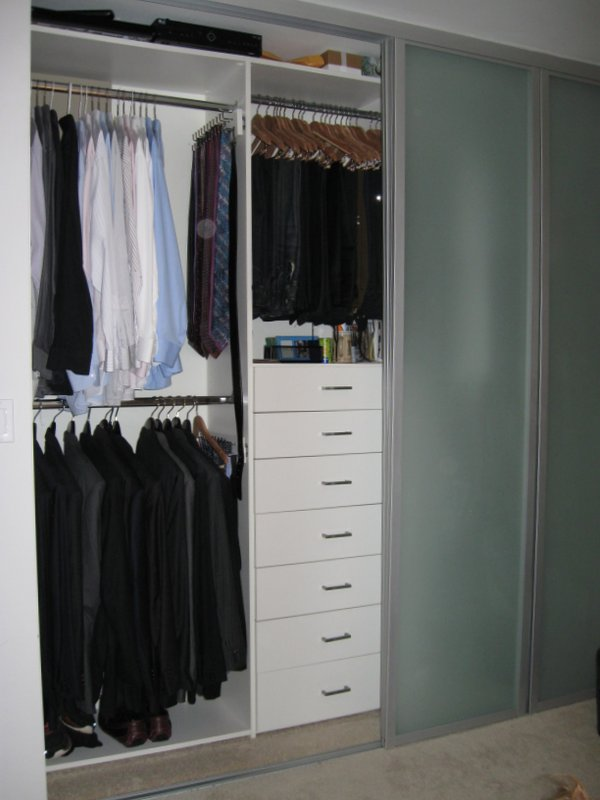 Mens, white melamine reach in closet  with drawers, folded clothes shelves and shoe Shelves