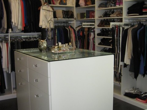 glass top closet island with drawers