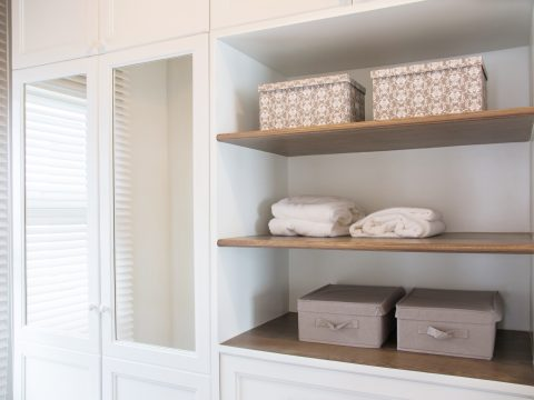Detail of walk in closet with wardrobe.
