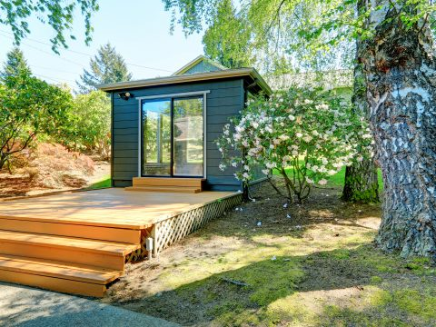 Small garden studio in a separate room with window walls.