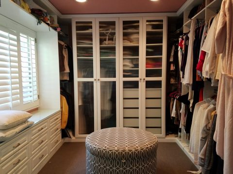 white closet and sitting space